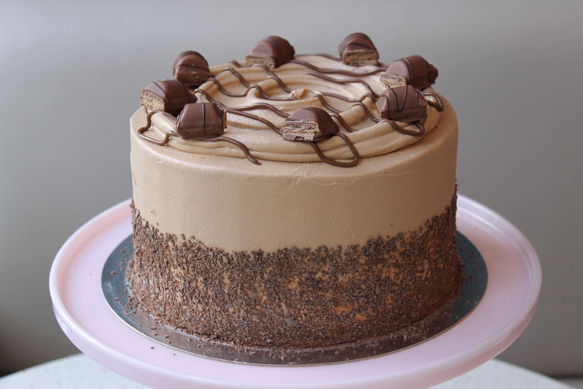 Decorating In White Kinder Bueno Layer Cake